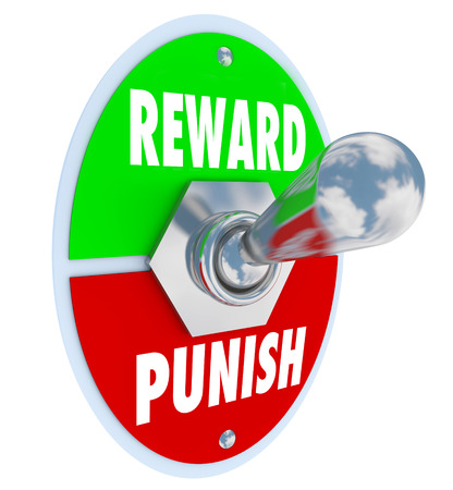 behaving: Reward and Punish words on a toggle switch or lever to illustrate disciplining a child, student or worker for good or bad behavior or performance