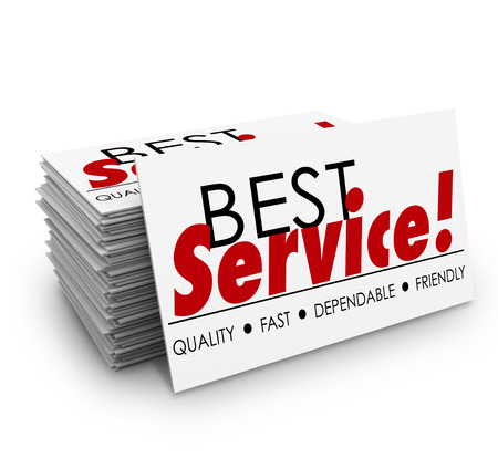 Best Service words on a business card stack or pile with terms describing your business including quality, fast, dependable and friendly