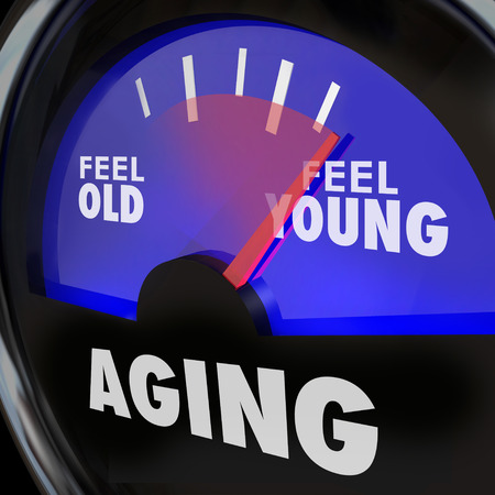 brain aging: Aging word on a gauge to illustrate difference between feeling old and young, with energy and vigor of a youthful lifestyle, mind body and spirit
