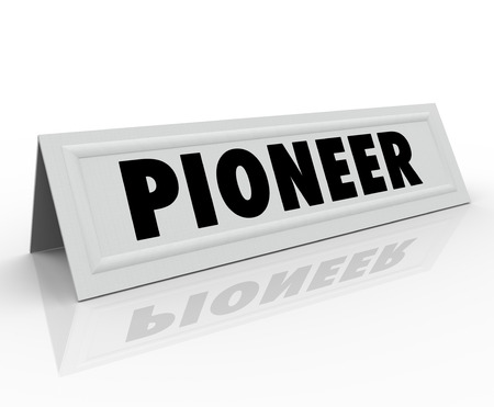 pioneer: Pioneer word on a name tent card for a speaker or guest panelist who is the originator or first business inventor of a new revolution Stock Photo
