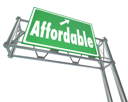 afford: Affordable word on a green freeway sign to illustrate a great value or low cost sale or bargain price