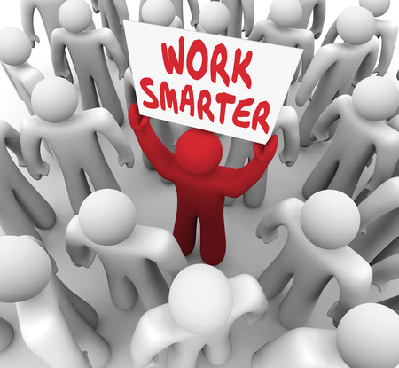 common sense: Work Smarter words on a sign held up by a worker or employee trying to improve or increase efficiency and productivity