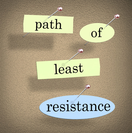 a bulletin board: Path of Least Resistance words pinned to a bulletin board as a saying of advice to avoid conflict, problems or difficulty and choose the easy solution