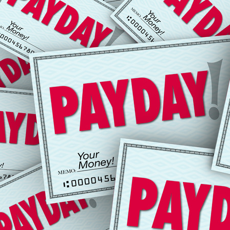 compensated: Payday word on checks in a pile of earnings, compensation, wages or income earned from working your job Stock Photo