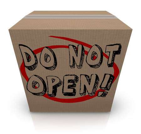 Do Not Open words on a cardboard box to illustrate a package or parcel that is secret, confidential, sensitive, classified, private, or a surprise gift or present forbidden to you