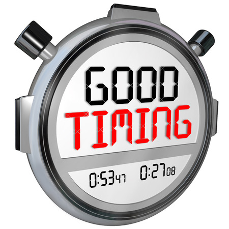 finished good: Good Timing words on a stopwatch or timer marking your fast speed or quick arrival at just the right moment Stock Photo
