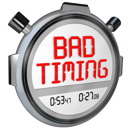 missed: Bad Timing words on a stopwatch or timer to illustrate a missed opportunity, slow speed or late arrival