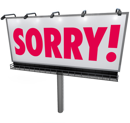 public offering: Sorry word in red letters on an outdoor billboard or sign asking for forgiveness in a public message of apology, remorse and regret Stock Photo