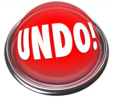 Undo word on a red button to illustrate repair, fix, change or correction to an error, mistake, problem or difficult challenge Imagens