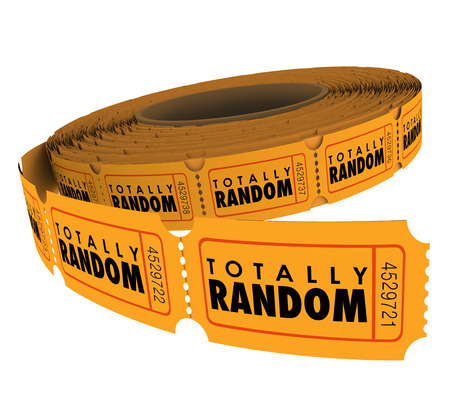 raffle: Totally Random words on raffle tickets in a roll to illustrate randomness and unpredictible choice in picking a lucky winner