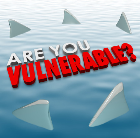 vulnerability: Are You Vulnerable question in 3d letters and words surrounded by shark fins to ask if you are at risk of deadly force or danger from competition or criminals Stock Photo