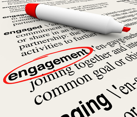Engagement word circled in a dictionary definition to illustrate meaning of the word in business attracting customers with involvement and participation 版權商用圖片