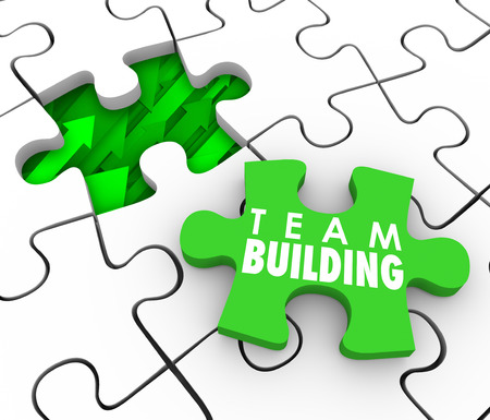 work together: Team Building Words on a puzzle piece to fill a hole , business or organization with new people or employees who will work together to achieve a common goal
