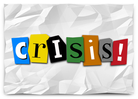 ransom: Crisis word in cut out letters on crumpled paper like a ransom note to convey a message of emergency, urgency, bad situation, problem or trouble