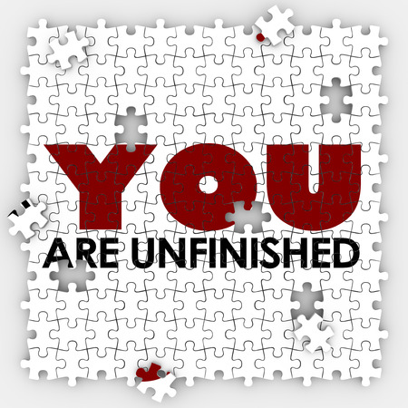 acceptance: You Are Unfinished words on puzzle pieces to illustrate self improvement and acceptance of your skills and abilities that are incomplete or imperfect Stock Photo