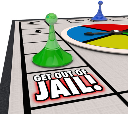 Get Out of Jail words on a board game and player piece moving to illustrate escaping from prisoner after arrest and court