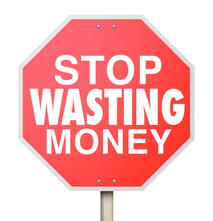 cost reduction: Stop Wasting Money words on a red warning sign telling you to cut overbudget spending and avoid debt and bankruptcy Stock Photo