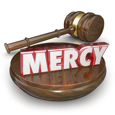 forgiven: Mercy 3d word in red letters on a gavel to illustrate lenient sentencing in a verdict or judgment in a court legal trial case
