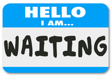 tardy: Hello I Am Waiting words on a nametag sticker to illustrate being patient, late, tardy or delayed for a trip, appointment, meeting or event