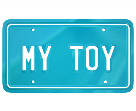 show off: My Toy words on a vehcile license plate to illustrate a car collector or restoration hobby or pasttime