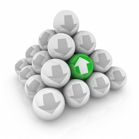 recuperate: One unique green up arrow ball in pyramid going against the trend of down or decrease to illustrate increasing or good improvement in a bad market Stock Photo