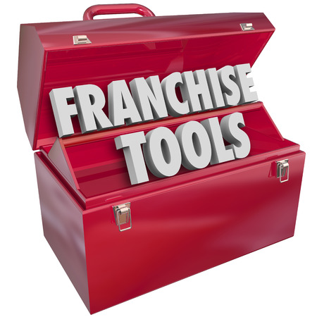 franchises: Franchise Tools words in a red metal toolbox to illustrate help, assistance or advice for starting or launching a new licensed company or business in a chain Stock Photo