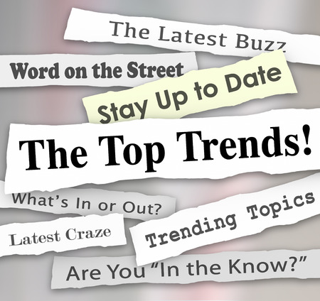 popular: The Top Trends words in newspaper headlines to illustrate the hottest or latest new ideas, products, fads, fashions or innovations popular and in demand by customers Stock Photo
