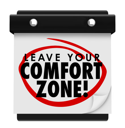 quo: Leave Your Comfort Zone words on a wall calendar telling you to experience new things and be brave and courageous in life