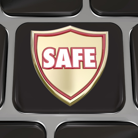 criminal activity: Safe word on a gold shield on computer keyboard key or black button to illustrate protection from virus, online theft or fraud or other danger or criminal activity Stock Photo