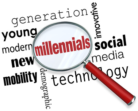 generational: Millennials word under a magnifying glass to illustrate searching for young people in the new demographic that is tech savvy, young, modern, innovative and into social media