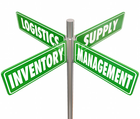 Inventory, Management, Logistics and Supply words on 4 green road or street signs pointing way to controlling chain of goods, merchandise or products at a company or business Foto de archivo