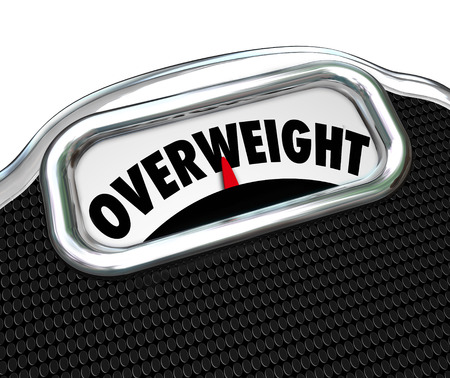 overeat: Overweight word on a scale to illustrate overeating and the need to lose weight with a diet and exercise regimen or plan