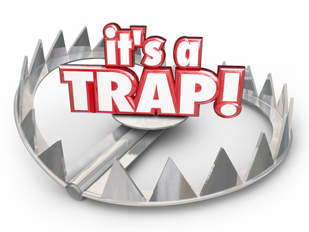 booby trap: Its a Trap word in red 3d letters on a steel bear trap to illustrate a dangerous trick, scam or bad situation