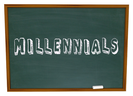 generation y: Millennials word written on a school chalkboard to illustrate young generation learning in class about social media, networking and technology