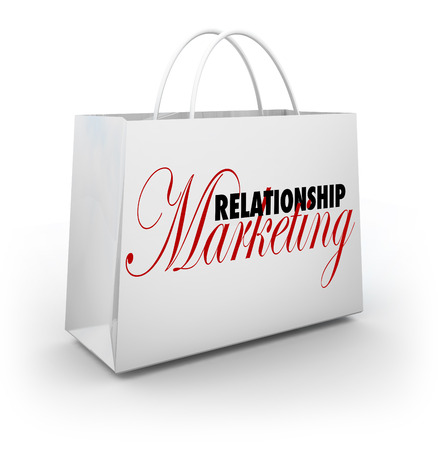 fostering: Relationship Marketing words on a shopping bag to illustrate customer or buyer loyalty and rewards for frequent purchases Stock Photo