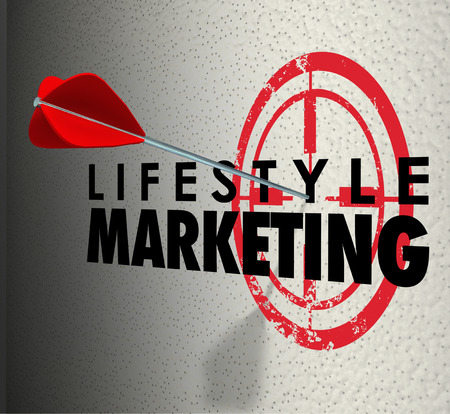 prospecting: Lifestyle Marketing words on a wall and arrow hitting the bulls-eye to illustrate targeting customers and prospects based on demographics, wants, needs, hobbies and interests Stock Photo