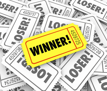 raffle ticket: Winner word on a golden or yellow ticket on a pile of Loser tickets as the lucky drawn winning entry in a jackpot or drawing for a big jackpot or prize