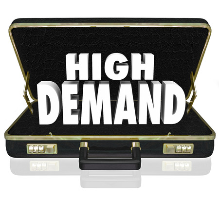 desired: High Demand word in white 3d letters in a black leather briefcase as a sales presentation or proposal for popular, wanted, desired products or services Stock Photo