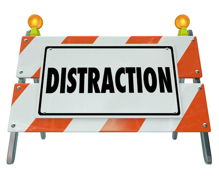 work: Distraction word on a road construction barrier or sign to illustrate dangerous inattentive driving or hazardous situation