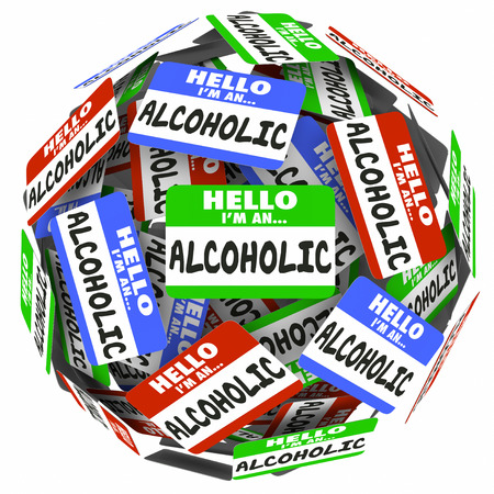 12 step: Hello Im an Alcoholic words written on name badges in a ball or sphere to illustrate support and help from a 12 step group to help you overcome addiction to drinking Stock Photo