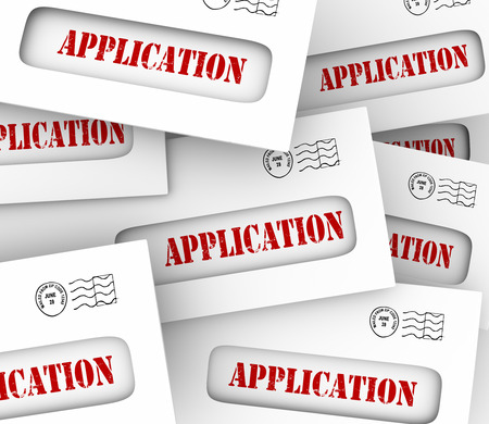 Application word on envelopes to illustrate many candidates, job offers or opportunities to find work or apply for credit from a bank or credit card company Stock Photo