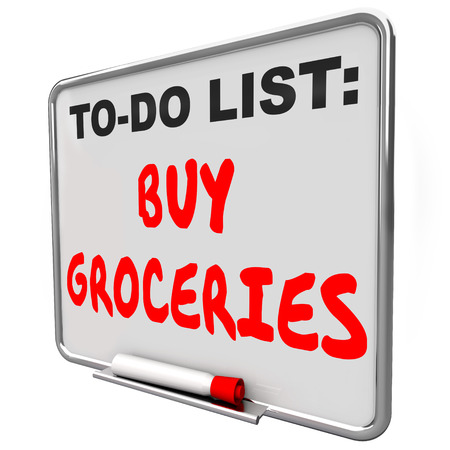 dry erase: Buy Groceries words written on a dry erase board to remind you to shop for food and other items at sa super market or store