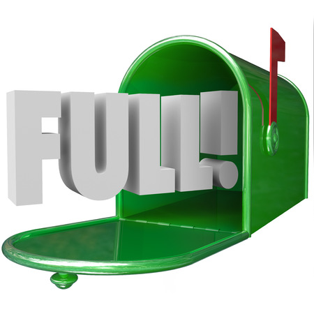 inbox: Full Word in 3d letters in a green metal mailbox to illustrate junk messages overflowing an email inbox Stock Photo
