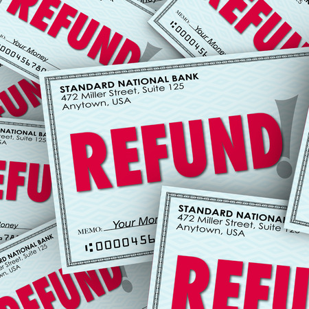 refunds: Refund word on checks as money back payments from taxes or rebates Stock Photo