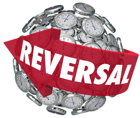 reversal: Reversal word on a red arrow pointing backward on a sphere or ball of clocks to illustrate changing course or direction Stock Photo