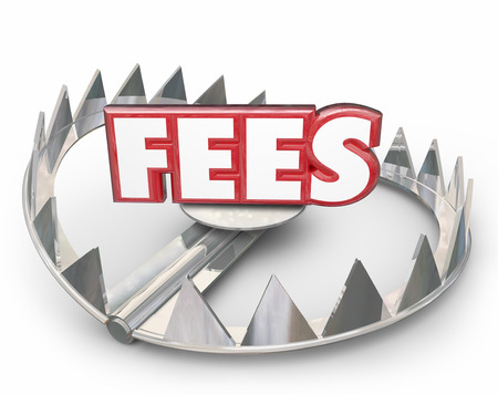 hidden costs: Fees word in red 3d letters on a steel bear trap with pointy teeth to illustrate or warn you of late payment penalty charged your account with high interest as a penalty Stock Photo