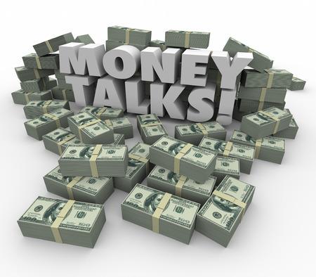 conversaciones: Money Talks palabras en letras 3d blancas rodeadas de staks o montones de d�lares que ilustran el poder y la influencia de la riqueza Foto de archivo