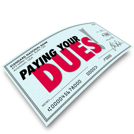required: Paying Your Dues words on a check to illustrate earning respect or achievement after performing required or obligated task or work Stock Photo