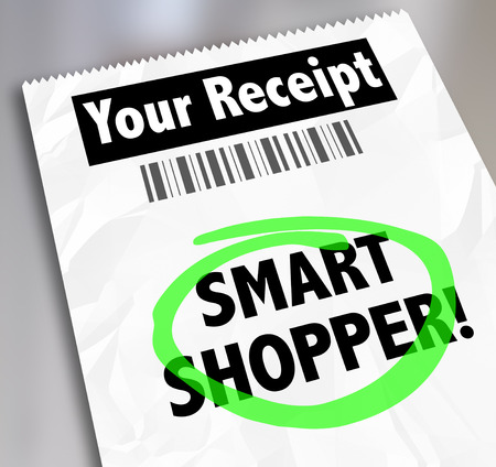smart: Smart Shopper words on a store receipt circled to illustrate spending money wisely Stock Photo