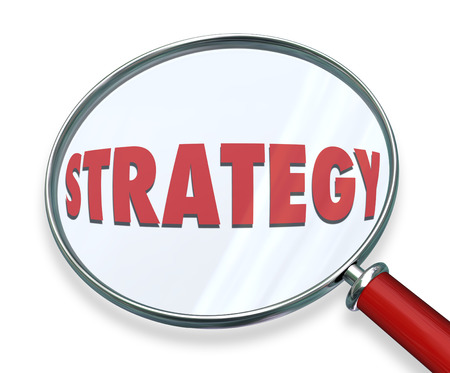 strategizing: Strategy word under magnifying glass to illustrate evaluating, assessing or examining the tactics, procedure and steps toward achieving mission, plan, objective and success